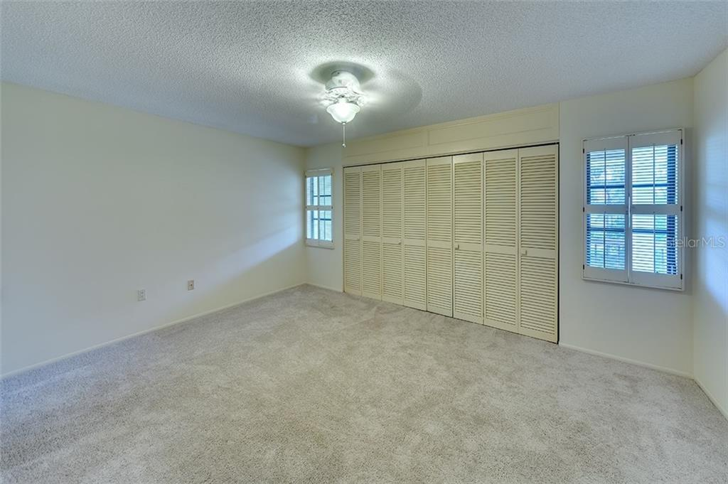 Large second bedroom with walk-in closet. - Condo for sale at 3920 Mariners Way #323a, Cortez, FL 34215 - MLS Number is A4416115