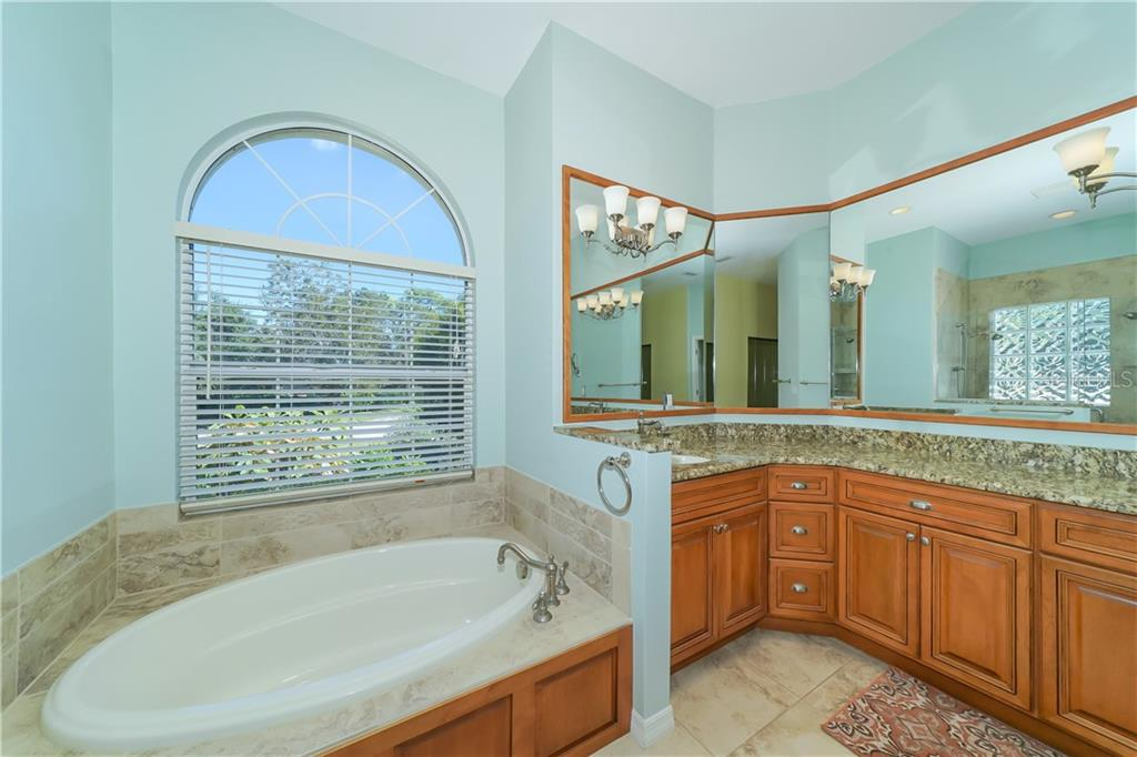 Rich cabinetry and double sinks - Single Family Home for sale at 1714 79th Ct W, Bradenton, FL 34209 - MLS Number is A4416601