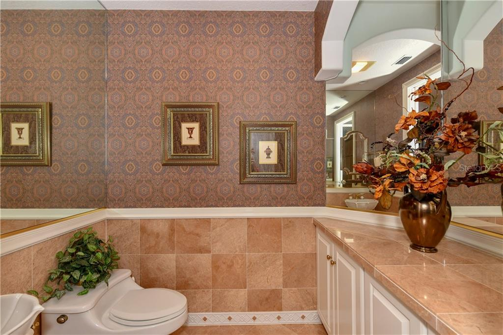 Powder Room (Half Bath) - Single Family Home for sale at 7659 Alister Mackenzie Dr, Sarasota, FL 34240 - MLS Number is A4416607