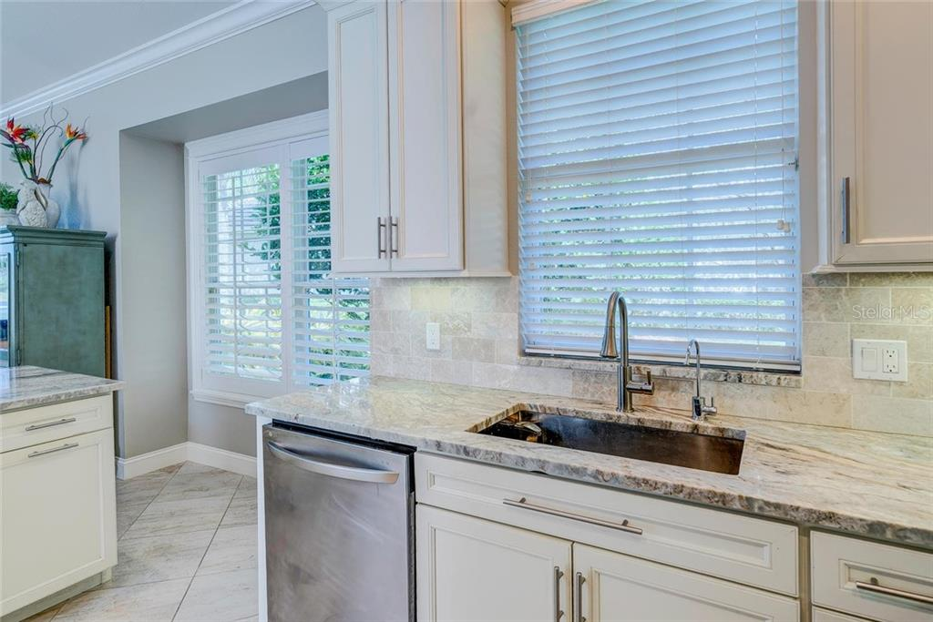Single bowl, stainless sink.  Beautiful granite countertops. - Single Family Home for sale at 7208 Kensington Ct, University Park, FL 34201 - MLS Number is A4416829