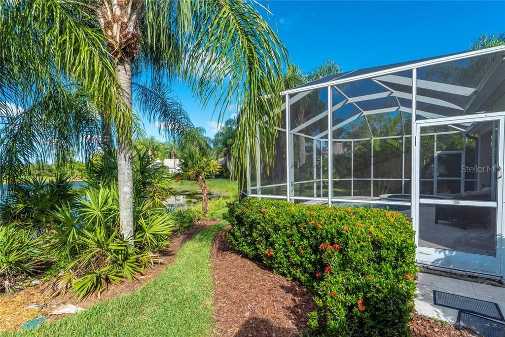 This blue sky, looking out at the lake, could be yours.  Opportunity to appreciate your own private pool and spa. - Single Family Home for sale at 7208 Kensington Ct, University Park, FL 34201 - MLS Number is A4416829