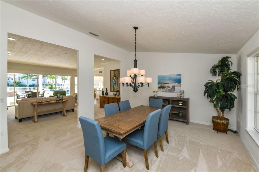 Dining to living to pool, to canal view. - Single Family Home for sale at 7689 Cove Ter, Sarasota, FL 34231 - MLS Number is A4417242