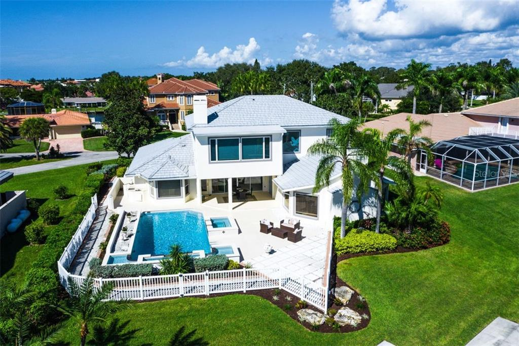 Incredible location, unforgettable views, terrific value. - Single Family Home for sale at 7689 Cove Ter, Sarasota, FL 34231 - MLS Number is A4417242