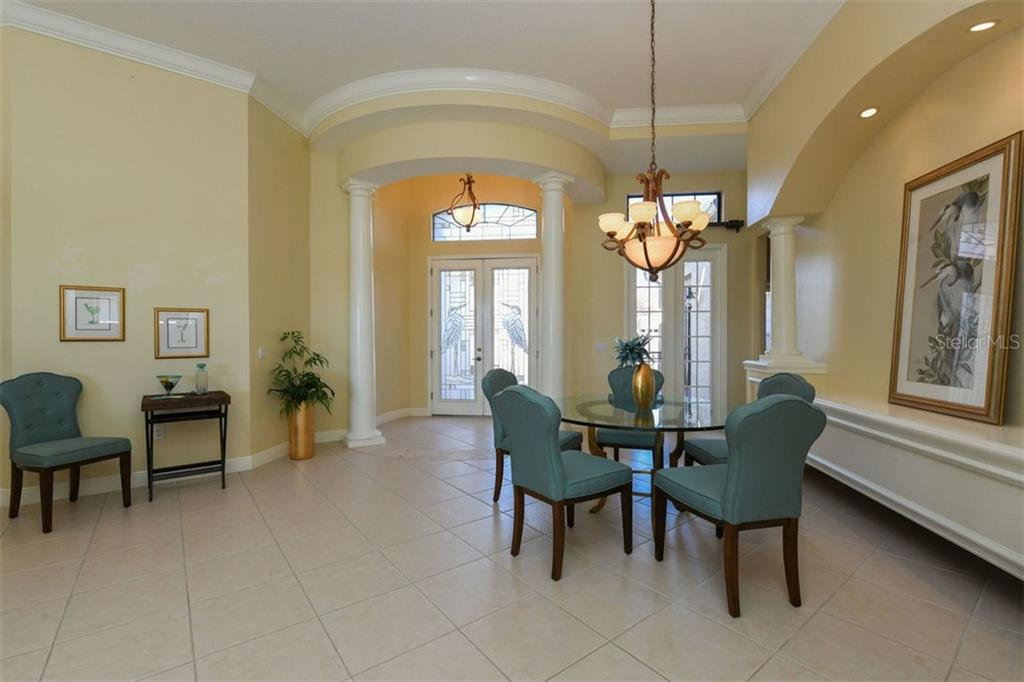 Beautiful Double Stained Glass Door Entrance with Architectural Detailing - Single Family Home for sale at 7060 Whitemarsh Cir, Lakewood Ranch, FL 34202 - MLS Number is A4417363