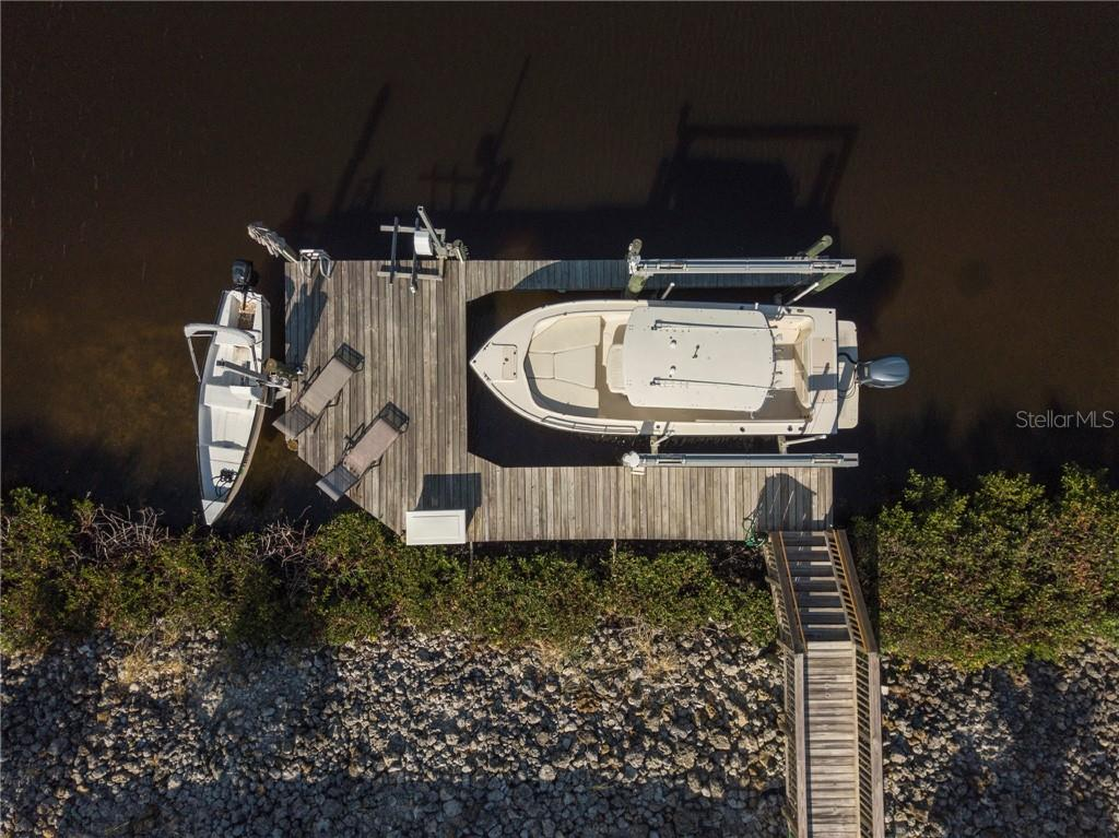 Spacious dock with three boat lifts for all of you water toys! - Single Family Home for sale at 3803 5th Ave Ne, Bradenton, FL 34208 - MLS Number is A4417524