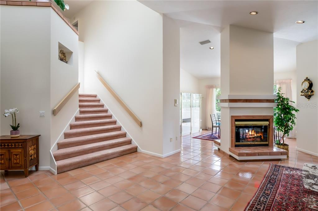 Grand staircase to 2nd floor, 2 sided fireplace - Single Family Home for sale at 4963 Oxford Dr, Sarasota, FL 34242 - MLS Number is A4417783