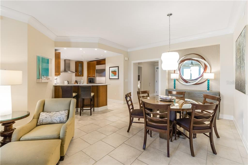 Sit and dine at the bar, dining room or out on the terrace. - Condo for sale at 915 Seaside Dr #610, Sarasota, FL 34242 - MLS Number is A4417976
