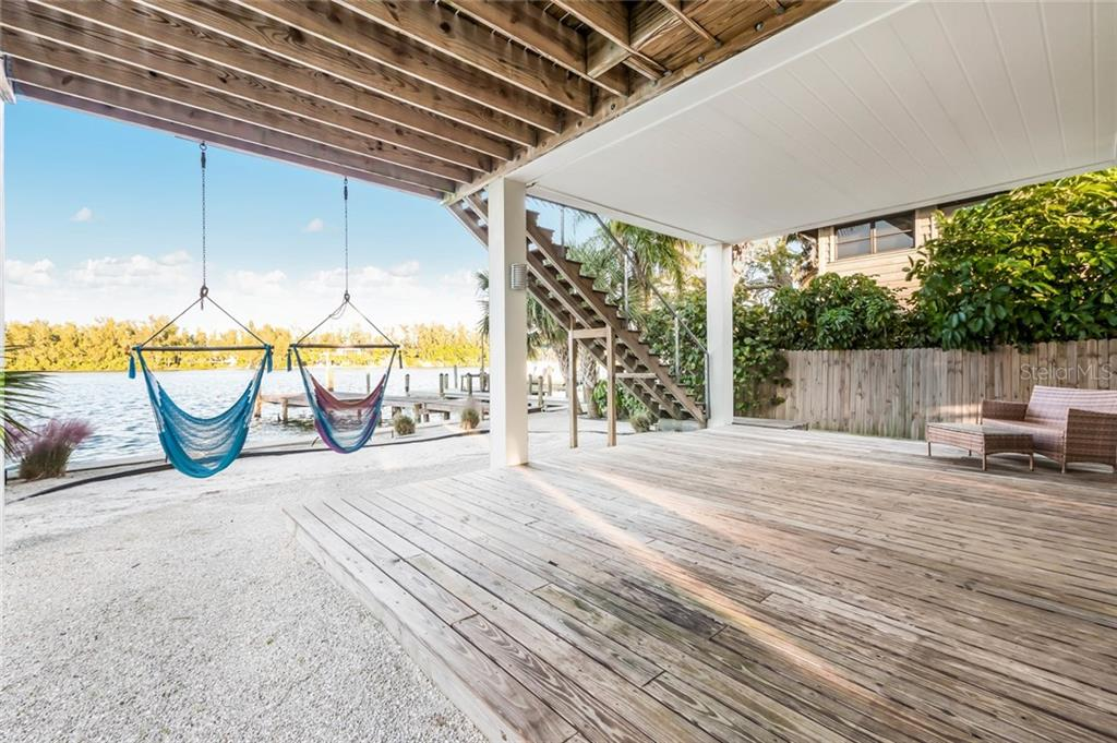Covered back patio - Single Family Home for sale at 7130 Longboat Dr E, Longboat Key, FL 34228 - MLS Number is A4418105