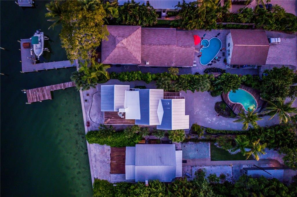 Aerial view at twilight - Single Family Home for sale at 7130 Longboat Dr E, Longboat Key, FL 34228 - MLS Number is A4418105
