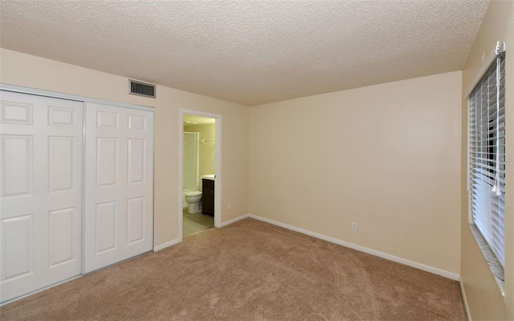 Guest Bedroom with Bathroom - Condo for sale at 4576 Longwater Chase #59, Sarasota, FL 34235 - MLS Number is A4418168