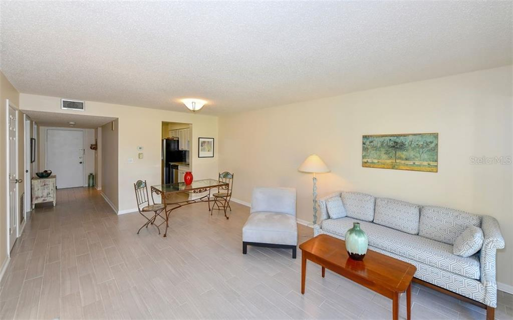 Gorgeous tile throughout Main Living areas - Condo for sale at 4576 Longwater Chase #59, Sarasota, FL 34235 - MLS Number is A4418168