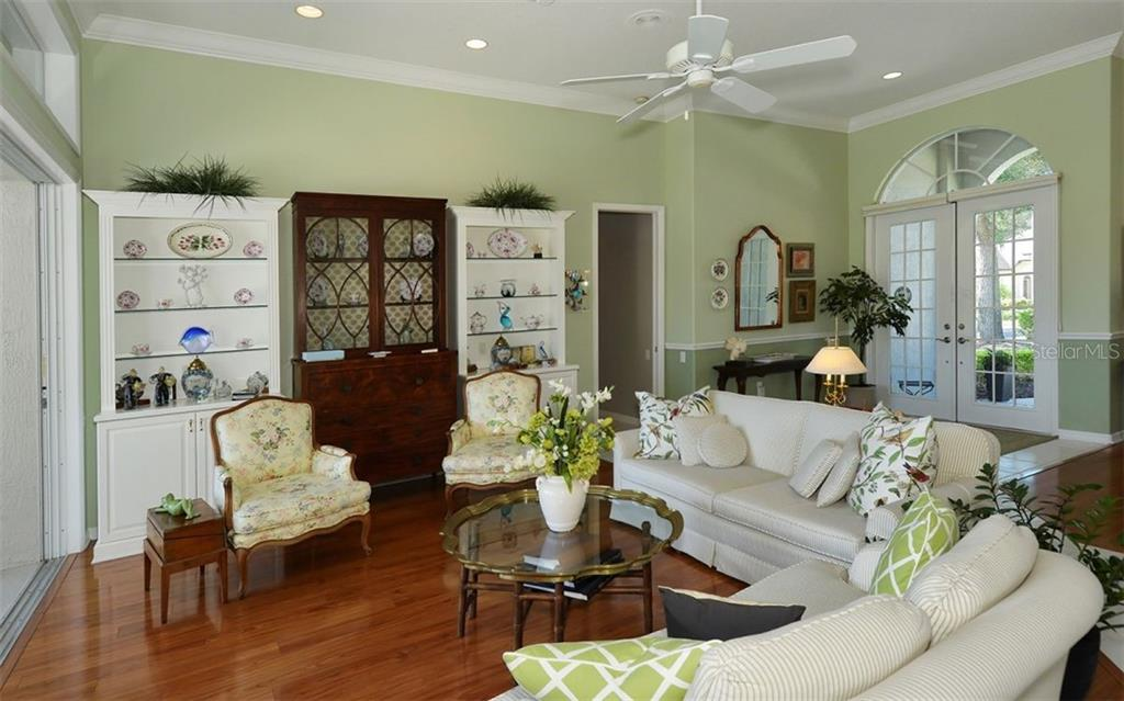 Living room to foyer - Single Family Home for sale at 462 Sherbrooke Ct, Venice, FL 34293 - MLS Number is A4418225