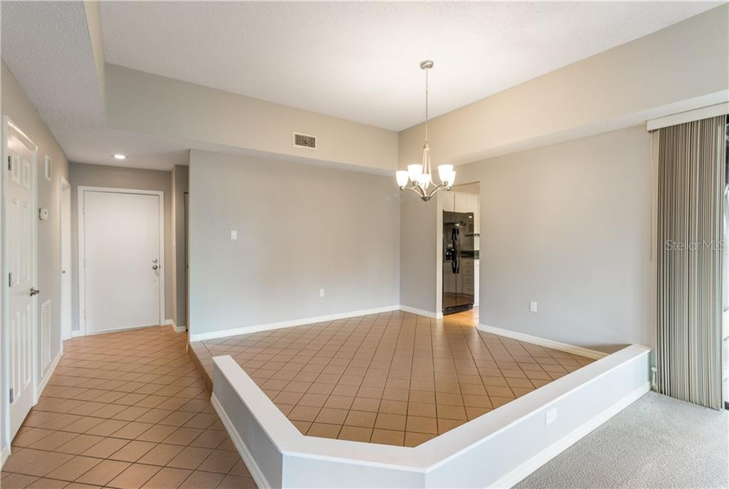 Designated Raised  Dining Room - Villa for sale at 5235 Myrtle Wood #18, Sarasota, FL 34235 - MLS Number is A4418558