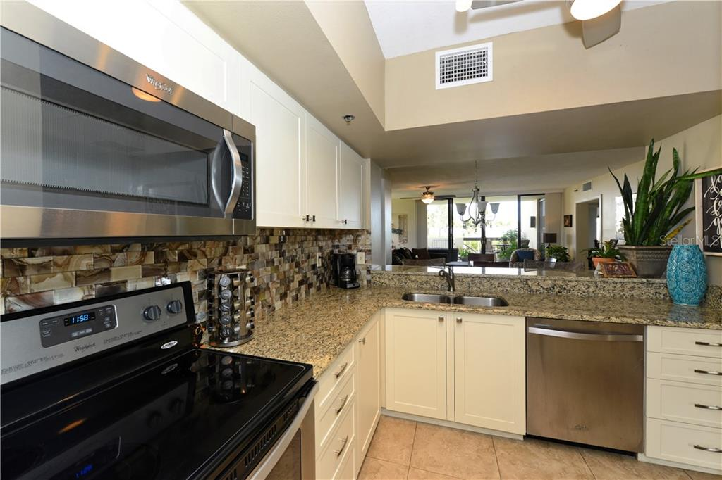 Kitchen with amazing water views - Condo for sale at 1930 Harbourside Dr #117, Longboat Key, FL 34228 - MLS Number is A4420232