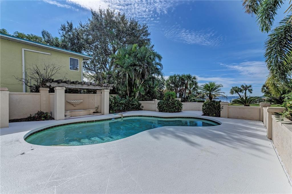 PROPERTY AERIAL VIEW - Photo taken in 2015 - Single Family Home for sale at 5110 Sun Cir, Sarasota, FL 34234 - MLS Number is A4420424