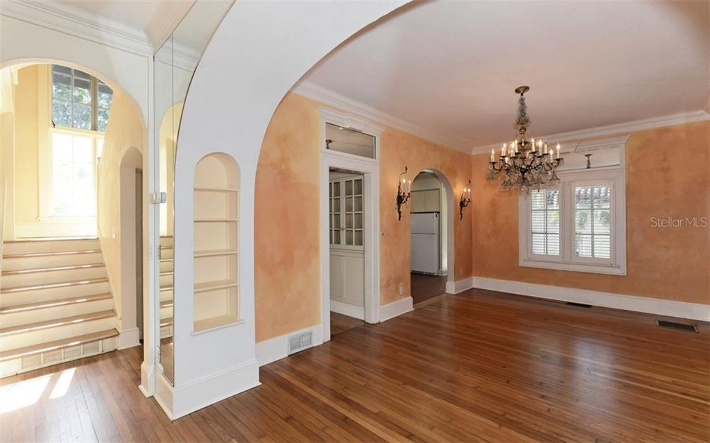 Grand archways & staircase. - Single Family Home for sale at 2262 Okobee Dr, Sarasota, FL 34239 - MLS Number is A4421275