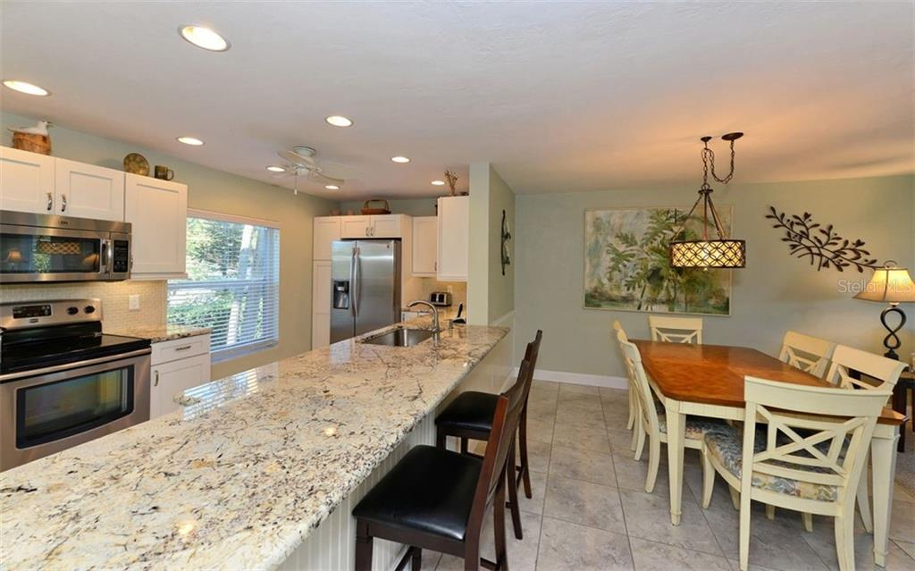 Gorgeous Bay views off your private glassed off terrace that you can use as an extra dining area, office/den or sleeping quarters. - Condo for sale at 4540 Gulf Of Mexico Dr #201, Longboat Key, FL 34228 - MLS Number is A4422082