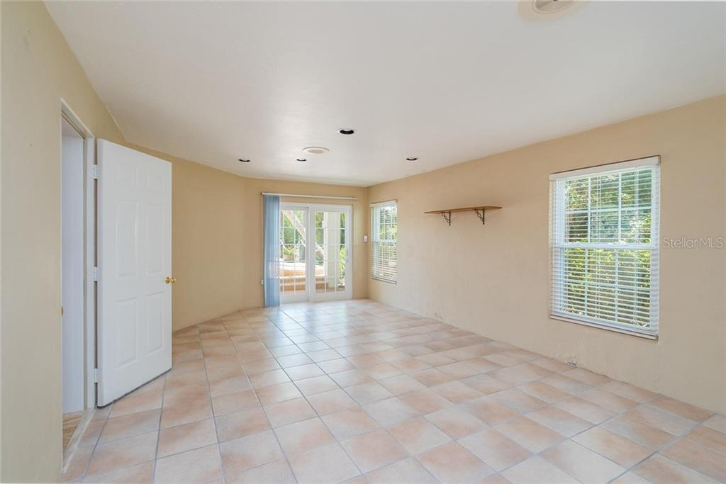 Poolside storage/exercise room - Single Family Home for sale at 3640 Flamingo Ave, Sarasota, FL 34242 - MLS Number is A4422130