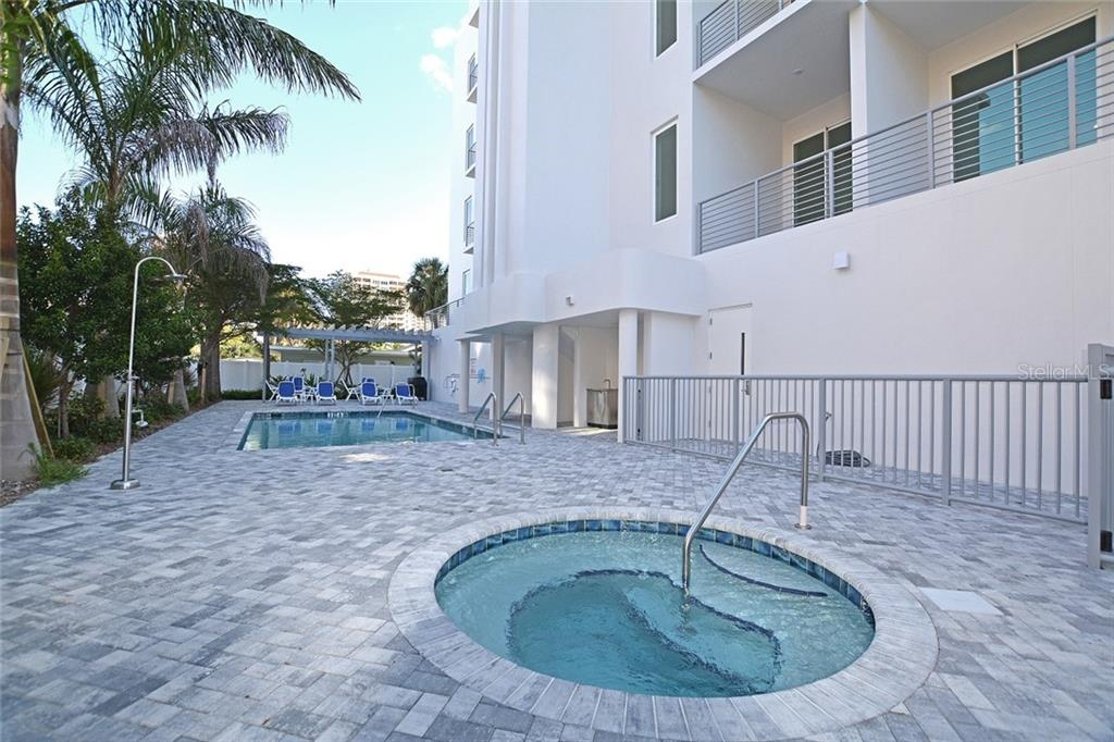 Walk to the farmer's market, Whole Foods, many specialty boutiques, art shops, dining & theatre venues. - Condo for sale at 609 Golden Gate Pt #201, Sarasota, FL 34236 - MLS Number is A4422340