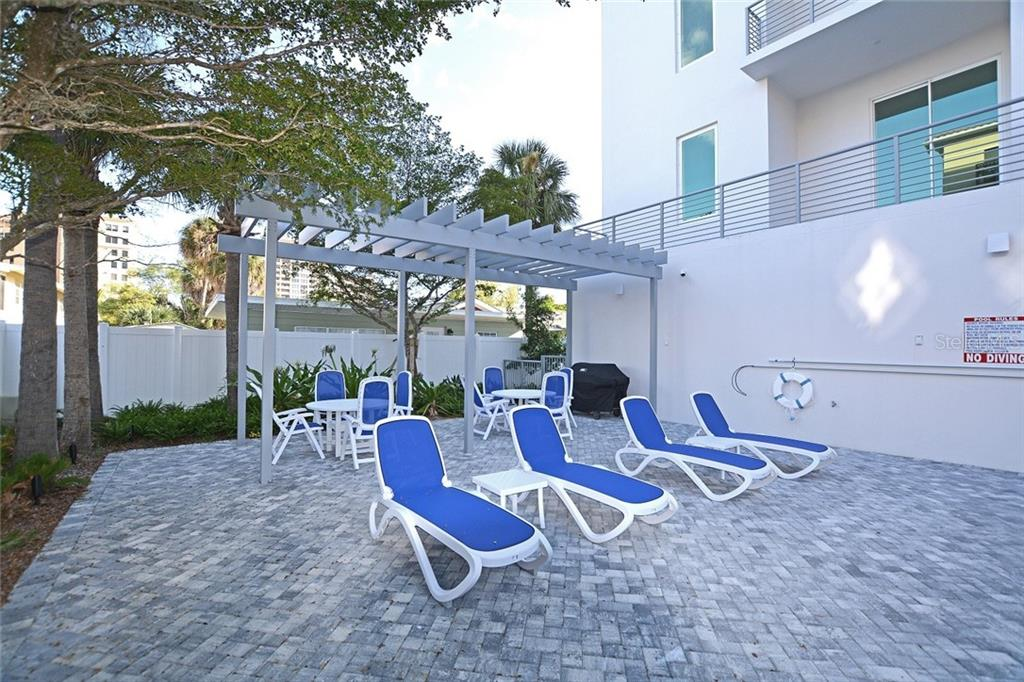 Spacious living area open to dining, kitchen and nearby den. - Condo for sale at 609 Golden Gate Pt #201, Sarasota, FL 34236 - MLS Number is A4422340