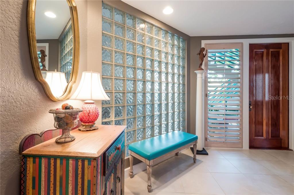 Costa Rican Mahogany Doors - Found throughout the Home - Condo for sale at 350 Gulf Of Mexico Dr #217, Longboat Key, FL 34228 - MLS Number is A4422560