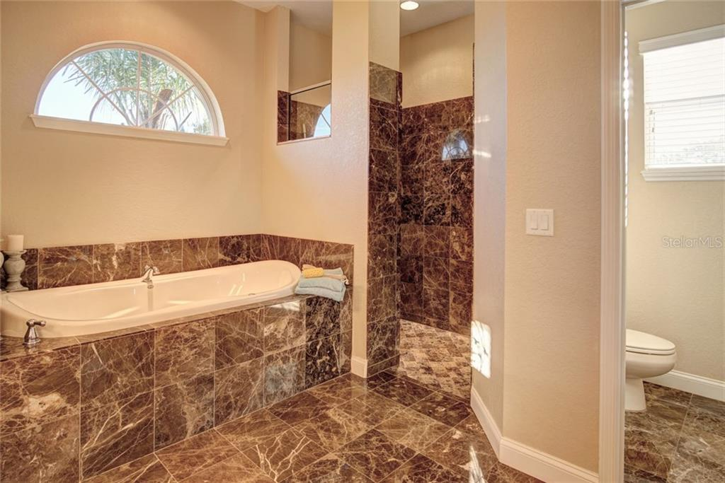 Kitchen nook overlooking pool area - Single Family Home for sale at 29425 Saddlebag Trl, Myakka City, FL 34251 - MLS Number is A4422648
