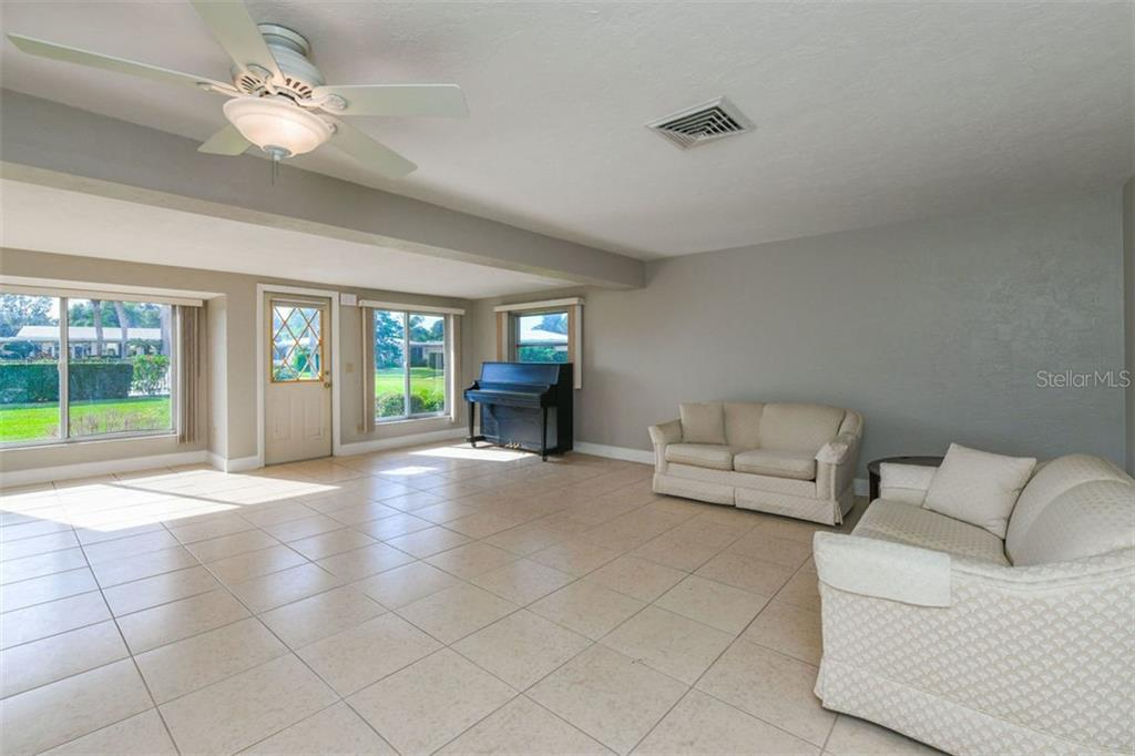 Living room. - Villa for sale at 3434 Medford Ln #1110, Sarasota, FL 34239 - MLS Number is A4422897