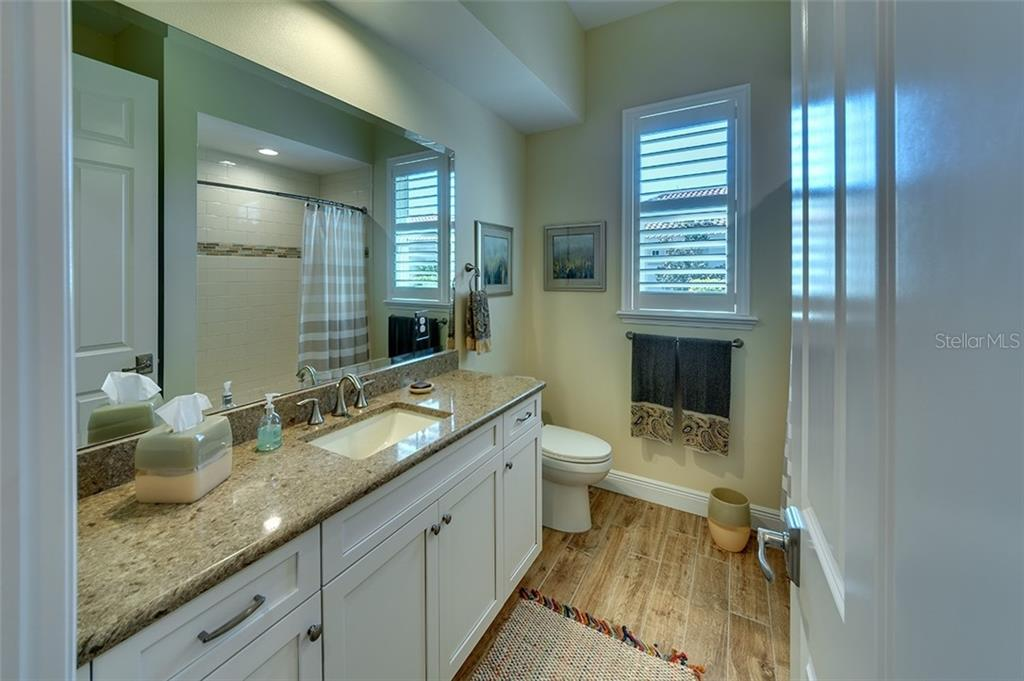 2nd bath has a tub and shower. - Single Family Home for sale at 19452 Beacon Park Pl, Bradenton, FL 34202 - MLS Number is A4422948