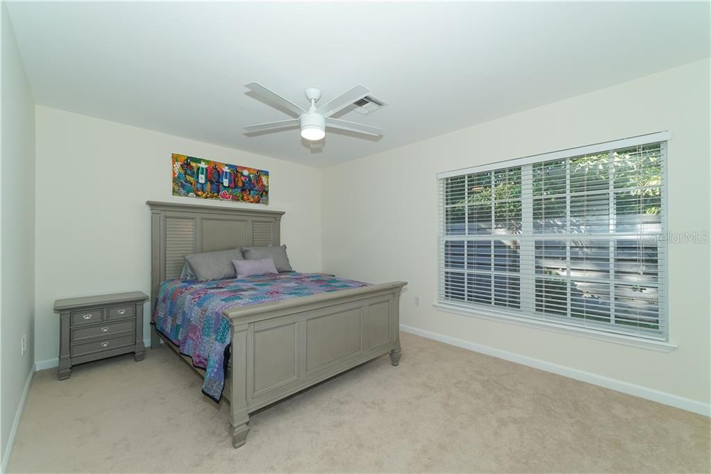 Large Secondary Bedrooms...this is the 2nd Bedroom with a queen sized bed. - Single Family Home for sale at 2300 Mietaw Dr, Sarasota, FL 34239 - MLS Number is A4423151