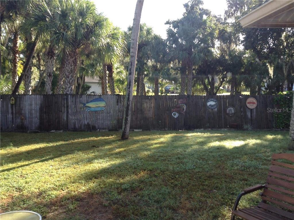 Back yard - Single Family Home for sale at 6909 43rd Ct E, Sarasota, FL 34243 - MLS Number is A4423173