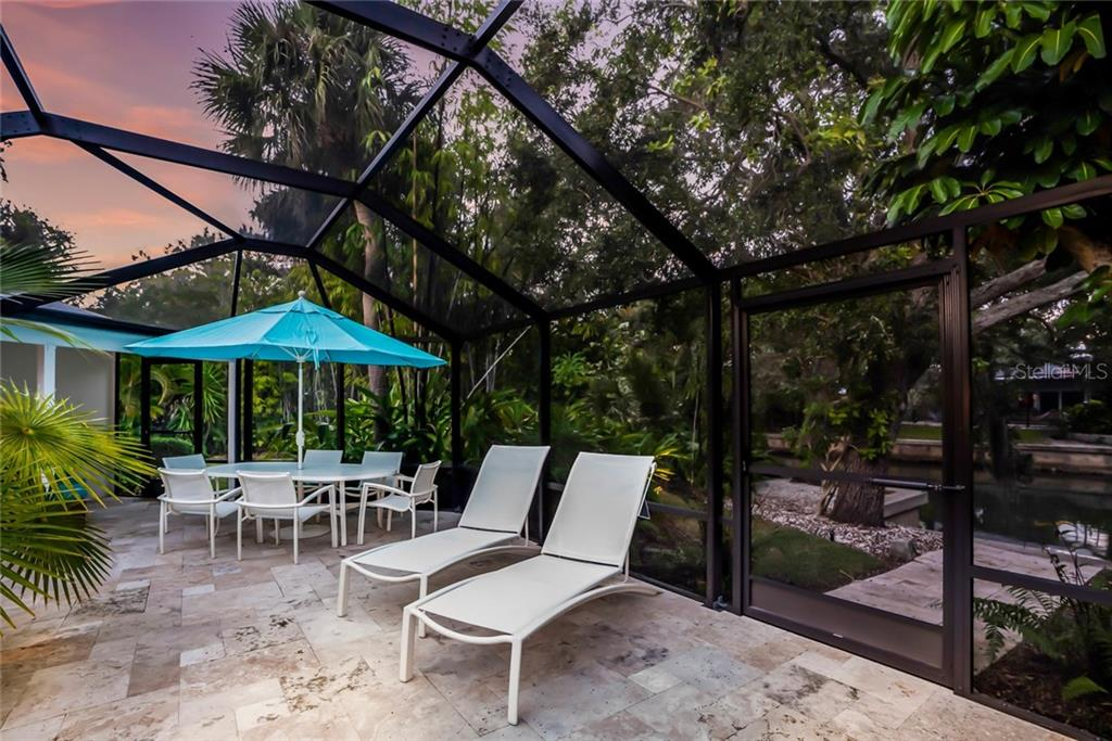 Unique Tropical pool - Single Family Home for sale at 6957 Belgrave Dr, Sarasota, FL 34242 - MLS Number is A4423362