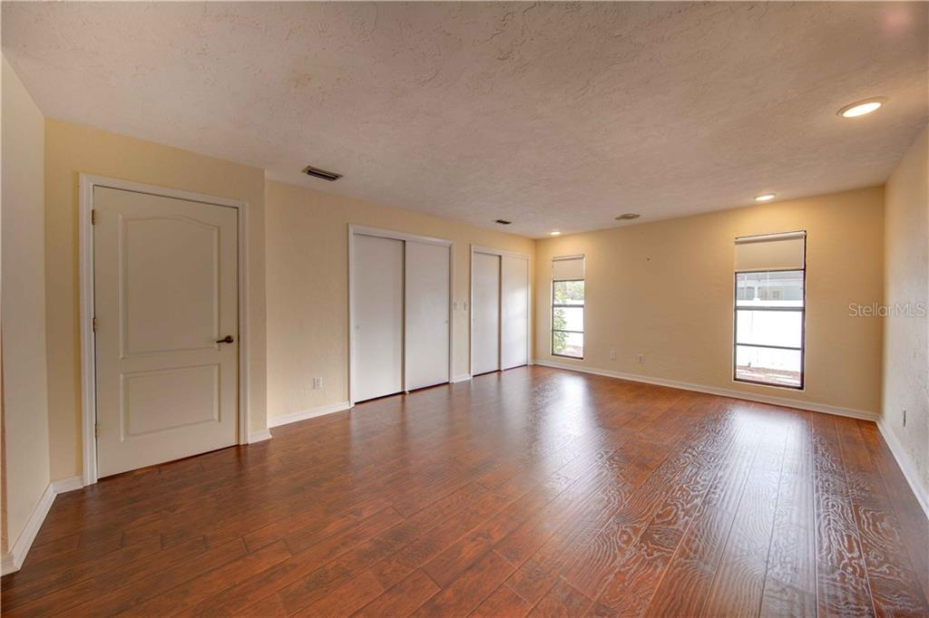 The large master bedroom with the same beautiful engineered wood floors, with 2 windows to the private backyard, double closets and a large master bath. - Single Family Home for sale at 6213 8th Avenue Dr W, Bradenton, FL 34209 - MLS Number is A4423560
