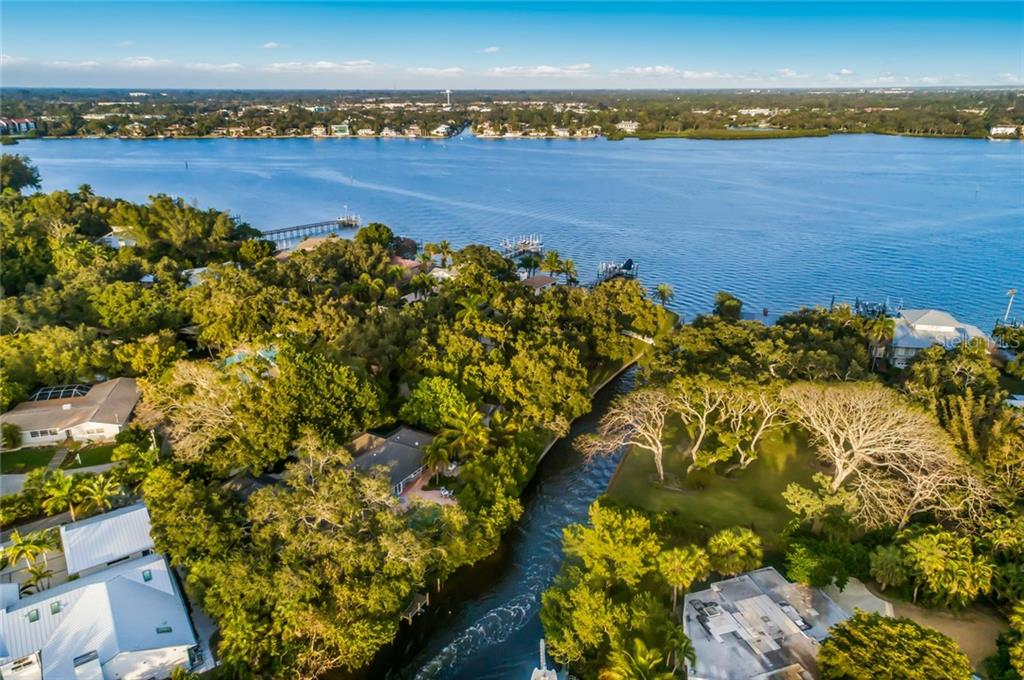 Boundary Survey & Elevation Certificate - Single Family Home for sale at 1253 N Basin Ln, Sarasota, FL 34242 - MLS Number is A4423797