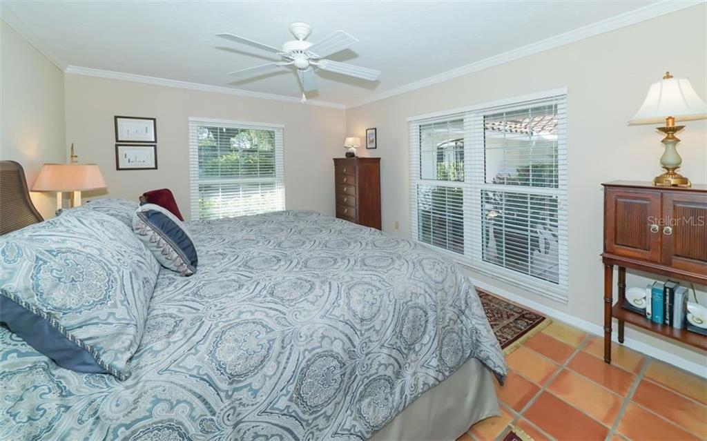 Second bedroom overlooks the courtyard - Single Family Home for sale at 510 63rd St Nw, Bradenton, FL 34209 - MLS Number is A4424601
