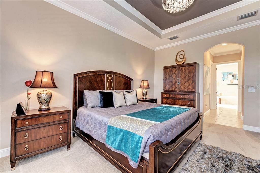 Master bedroom with Lexington furniture - Single Family Home for sale at 5712 Tidewater Preserve Blvd, Bradenton, FL 34208 - MLS Number is A4424693