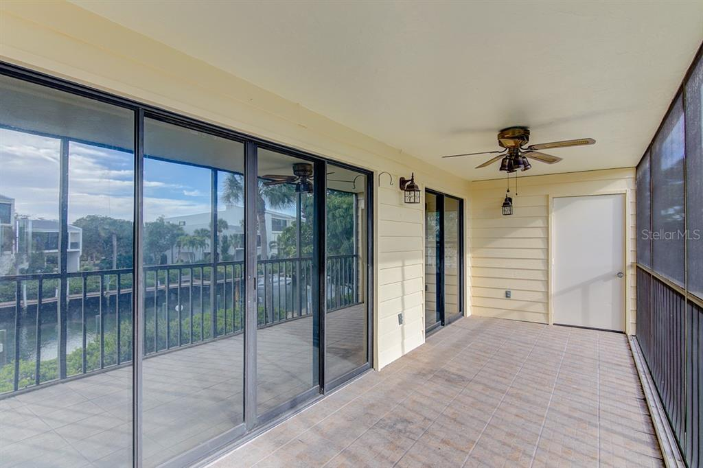 Porch w Living Rm & Master Bedroom Access - Condo for sale at 4115 129th St W #4115, Cortez, FL 34215 - MLS Number is A4424939