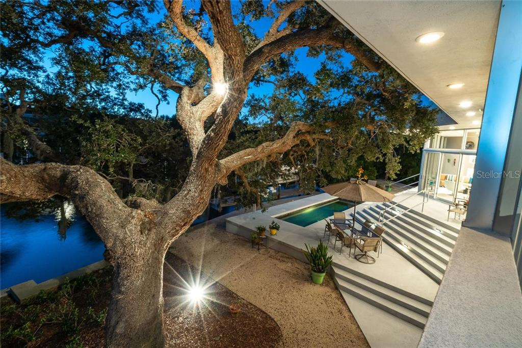 The design of the master suite was inspired to feel like it rests in the palm of this majestic ancient Oak overlooking the waterway. An open outdoor area hosts a 26 ft lap pool, composite boat dock and 16,000 lb boat lift with electric and water available. - Single Family Home for sale at 509 Venice Ln, Sarasota, FL 34242 - MLS Number is A4425092