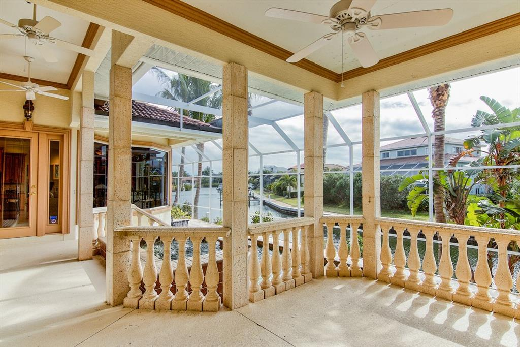 Outdoor entertaining area overlooking pool - Single Family Home for sale at 12518 Baypointe Ter, Cortez, FL 34215 - MLS Number is A4425873
