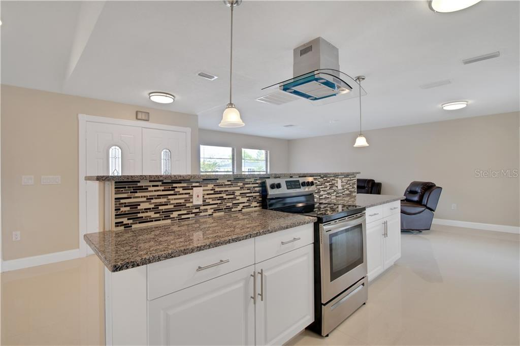 Kitchen view. - Single Family Home for sale at 23265 Mcburney Ave, Port Charlotte, FL 33980 - MLS Number is A4426235