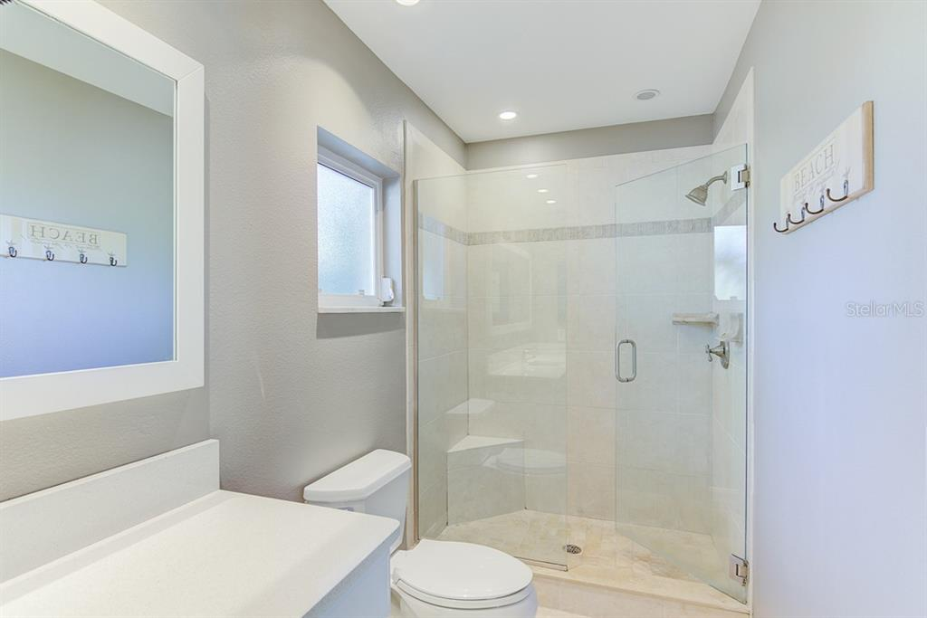 Guest Bathroom - Single Family Home for sale at 622 Dundee Ln, Holmes Beach, FL 34217 - MLS Number is A4426329