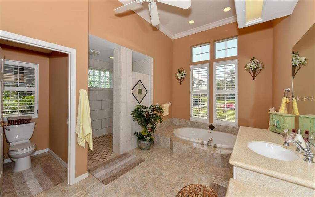 Walk in shower and separate tub in master bathroom - Single Family Home for sale at 7867 Estancia Way, Sarasota, FL 34238 - MLS Number is A4426528