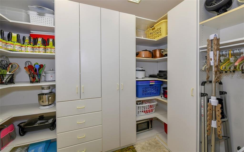 Oversized pantry just off the kitchen! - Single Family Home for sale at 7867 Estancia Way, Sarasota, FL 34238 - MLS Number is A4426528