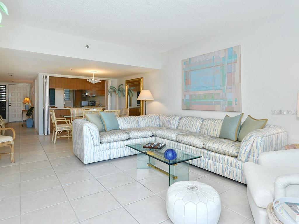 Open & Spacious Living & Dining Room - Condo for sale at 1125 Gulf Of Mexico Dr #202, Longboat Key, FL 34228 - MLS Number is A4427042