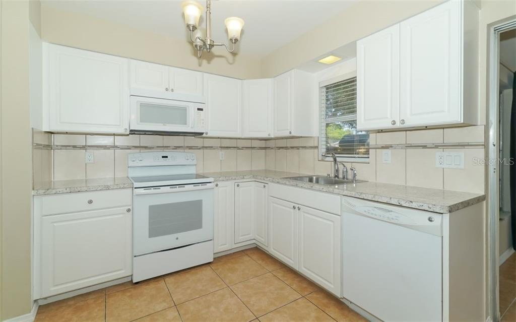 Kitchen - Single Family Home for sale at 2451 Wisteria St, Sarasota, FL 34239 - MLS Number is A4427390