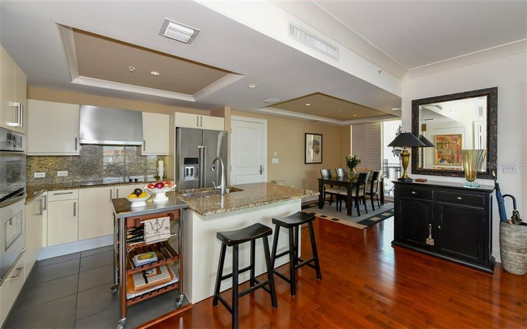 The kitchen and dining room which has its own terrace - Condo for sale at 1350 Main St #1201, Sarasota, FL 34236 - MLS Number is A4427507