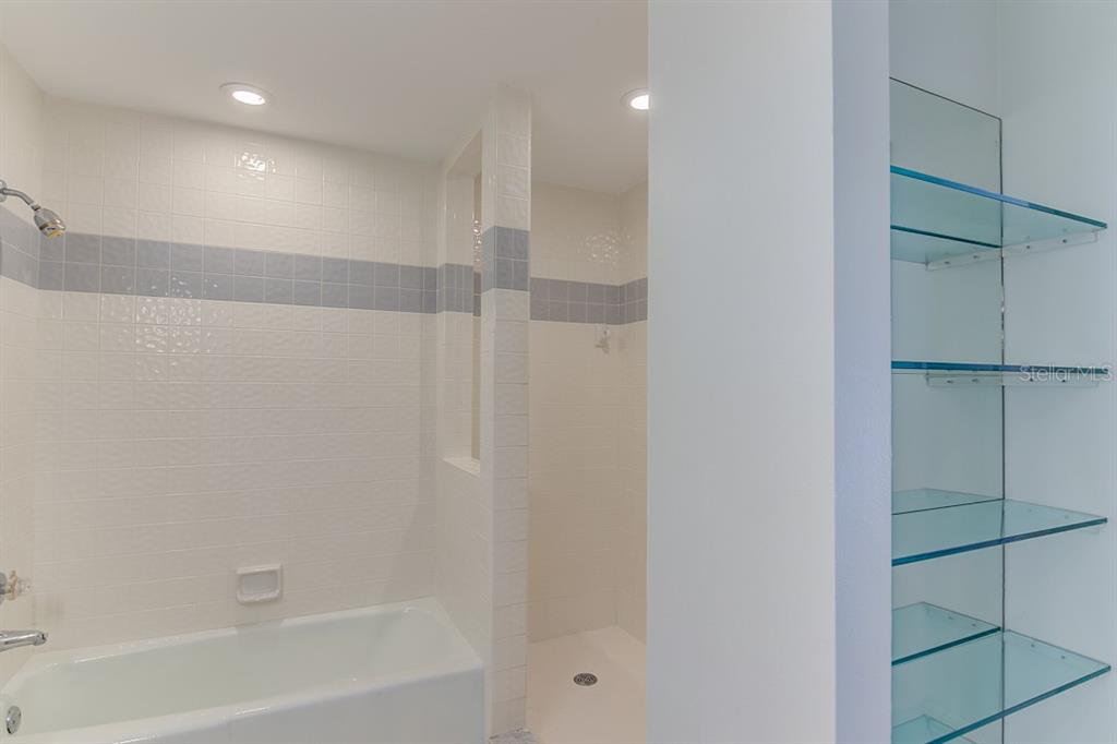 Master bathroom with tub and huge walk in shower - Condo for sale at 773 Benjamin Franklin Dr #7, Sarasota, FL 34236 - MLS Number is A4427752