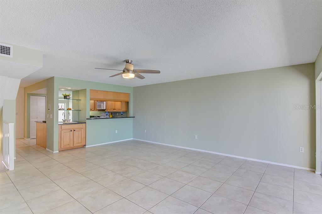 Dining/Living great room just off the kitchen with breakfast bar - Condo for sale at 773 Benjamin Franklin Dr #7, Sarasota, FL 34236 - MLS Number is A4427752