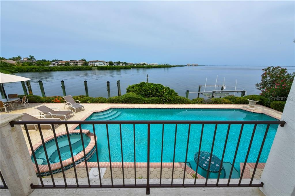 Elevated and elegant entrance with decorative brick pavers and lush mature landscape! - Single Family Home for sale at 591 Putter Ln, Longboat Key, FL 34228 - MLS Number is A4427895