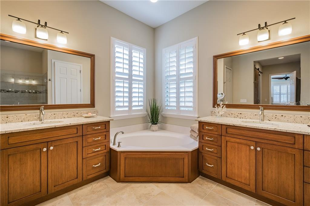 Mirrors are framed out by same wood as the vanities. - Single Family Home for sale at 595 Fore Dr, Bradenton, FL 34208 - MLS Number is A4428657