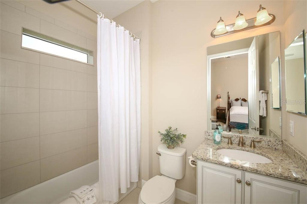 Bathroom 3 has tub and shower combination with natural light - Single Family Home for sale at 5504 Tidewater Preserve Blvd, Bradenton, FL 34208 - MLS Number is A4429479